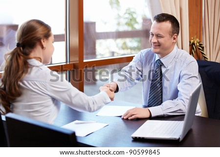 Business people shake hands - stock photo