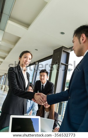 Business people shaking hand - stock photo