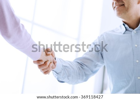 Business people shaking hands after a successful meeting, business relationships and cooperation concept - stock photo