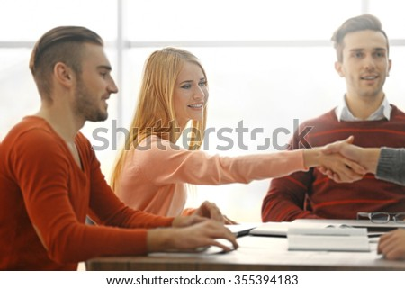 Business people shaking hands after meeting in a conference room - stock photo