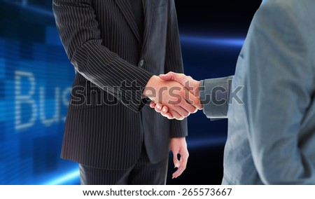 Business people shaking hands against business online on digital screen - stock photo