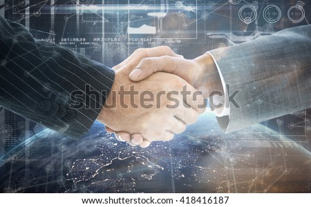 Business people shaking hands against image of a earth - stock photo
