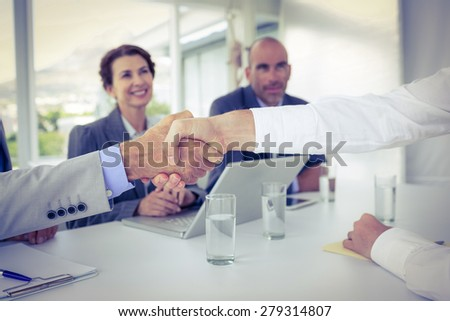Business people shaking hands at interview in the office - stock photo