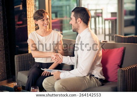 Business people shaking hands at the meeting in cafe - stock photo
