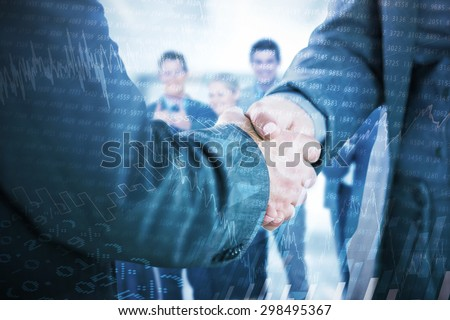 Business people shaking hands close up against stocks and shares - stock photo