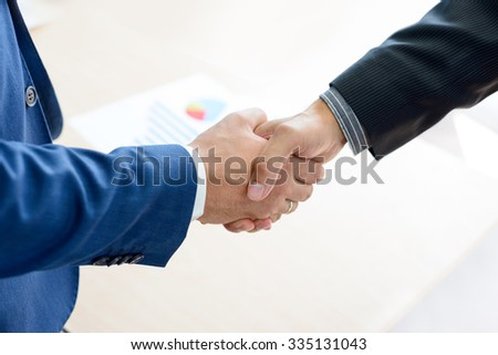Business People Shaking Hands Close-up. Business Partnership Concept - stock photo