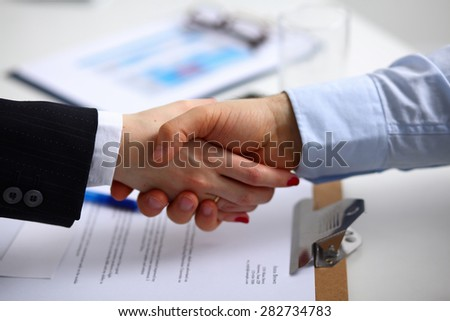 Business people shaking hands, finishing up a meeting . - stock photo