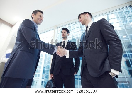 Business people shaking hands, finishing up a meeting in office - stock photo