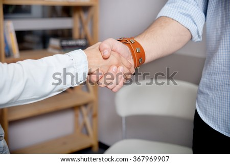 Business people shaking hands in the office, finishing a meeting, work in coworking - stock photo