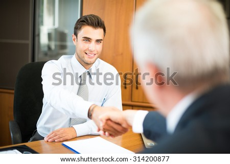 Business people shaking their hands - stock photo