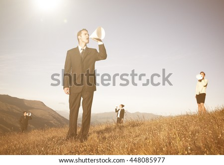 Business people shouting through paper megaphone - stock photo