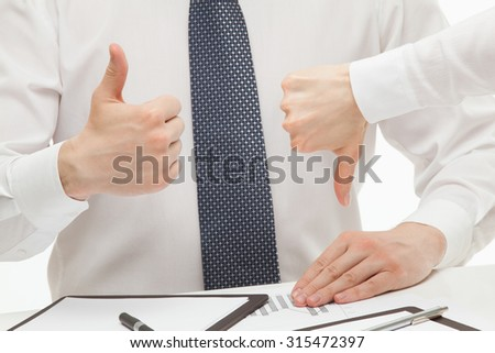 Business people showing different signs - thumb up and thumb down - stock photo
