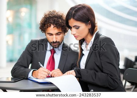 Business people signing a contract - stock photo