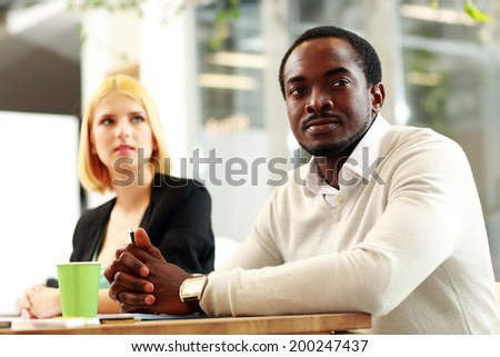 Business people sitting around a table during a meeting in office - stock photo