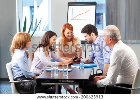 Business people sitting at meeting and  working on digital tablet. Teamwork at office. - stock photo