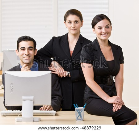 Business people smiling and posing together - stock photo