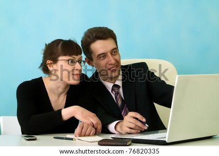 Business people smiling in office - stock photo