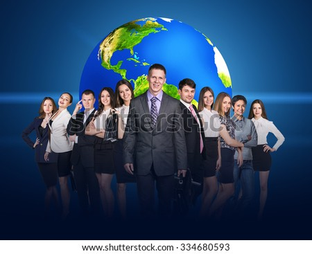 Business people stand on the blue background and big earth behind them. Elements of this image furnished by NASA - stock photo