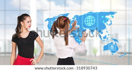 Business people standing in modern office and looking to global map. Elements of this image furnished by NASA - stock photo