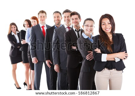 Business people standing in row over white background - stock photo