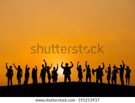 Business people standing outdoors celebrating success. - stock photo