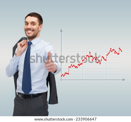 business, people, success and finances concept - smiling young businessman showing thumbs up gesture over gray background and forex graph going up - stock photo