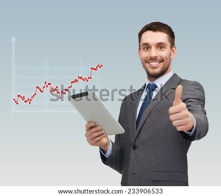 business, people, success and finances concept - smiling young businessman with tablet pc computer showing thumbs up gesture over gray background and forex graph going up - stock photo