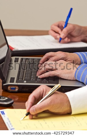 Business People Taking Notes At Business Meeting - stock photo