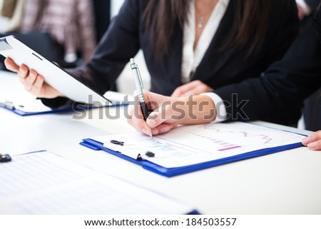 Business people taking notes during a meeting - stock photo