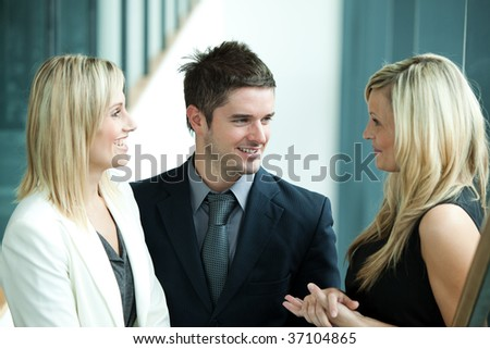 Business people talking about work in workplace - stock photo