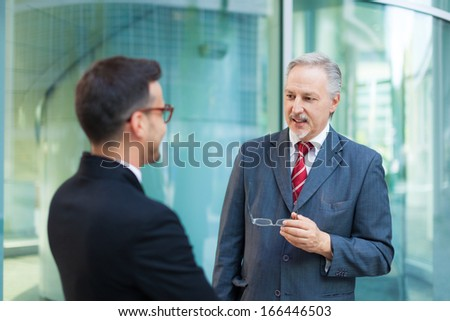 Business people talking together - stock photo