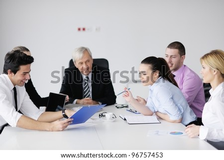 business people  team  at a meeting in a light and modern office environment. - stock photo