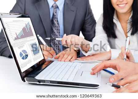 business people team work group during conference report discussing financial diagram, charts, on laptop screen businesspeople meeting sitting at desk office pointing hand finger at graph - stock photo