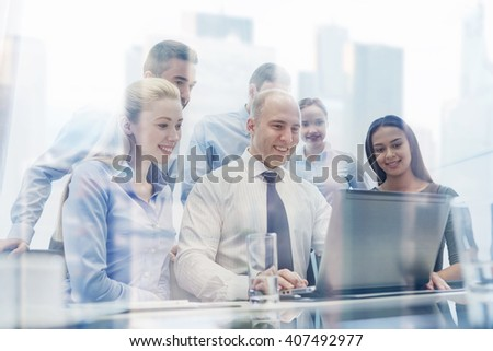 business, people, technology and communication concept - smiling business team with laptop computer making video conference in office - stock photo