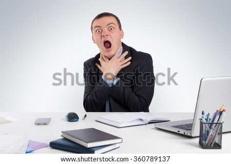 Business, people, time management and office concept -Businessman tries to strangle himself to despair.Concept of problems and solutions on gray background - stock photo