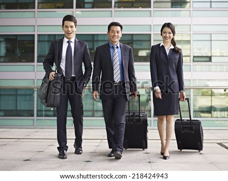 business people traveling with luggage. - stock photo