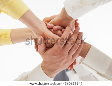 Business people uniting their hands - gesture of a union, white background - stock photo