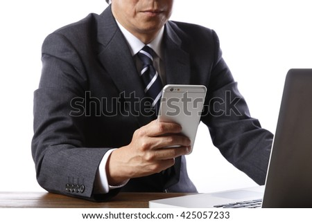 Business people use smart phones - stock photo