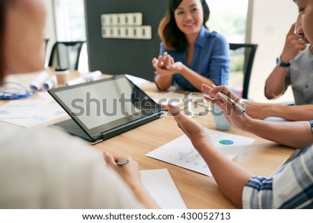 Business people using digital tablet at meeting in office - stock photo