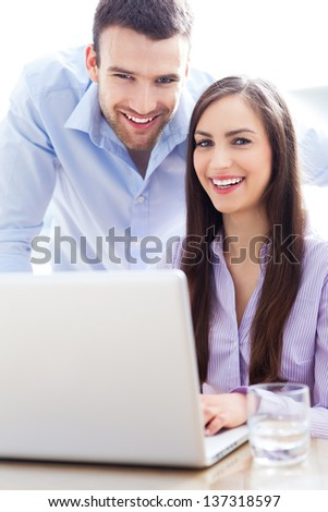 Business people using laptop - stock photo