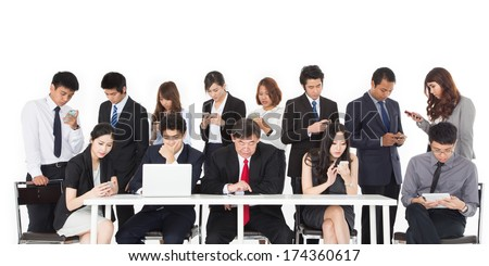 Business people using their communication devices while ignore each other in meeting - stock photo