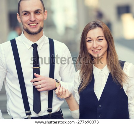 Business people walking and talking in the street. Business partners. Man and woman walking the street. - stock photo