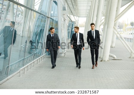 Business People Walking in the street - stock photo