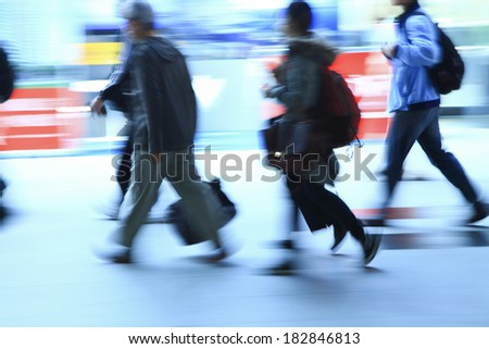 business people walking in train station in taiwan - stock photo