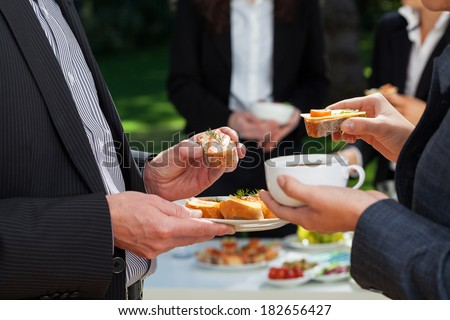 Business people who are eating lunch in the garden  - stock photo