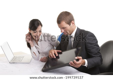 Business people with a small solar panel in the office - stock photo