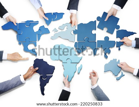 Business People with Jigsaw Puzzle Forming World Map - stock photo
