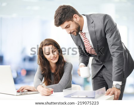 Business people with laptop, sitting at office and consulting. - stock photo