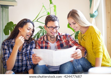 Business people with magazine. Exchange of new ideas and brainstorming between colleagues - stock photo