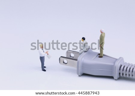 Business people with Plug - stock photo